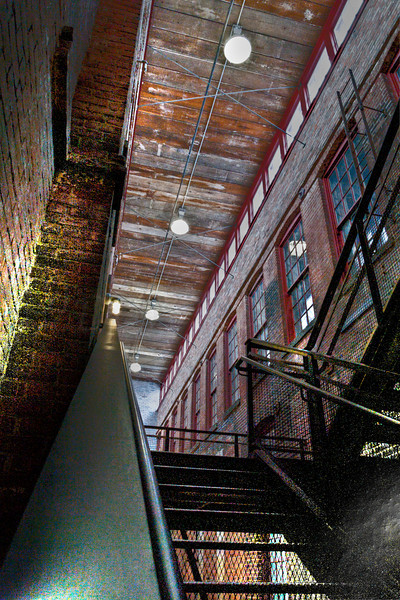 The three story hall between old factory builing sections of Mass MOCA