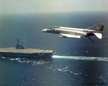 F-4N Phantom II (Project beeline) over the USS Ranger CV-61, off of San Diego. Last upgrade of Navy F4's before the F-14 Tomcat took over duties.