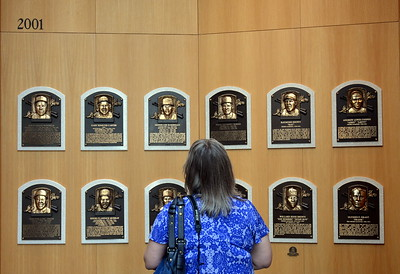 Looking at plaques in the Hall of Fame Gallery at  the National Baseball Hall of Fame & Museum