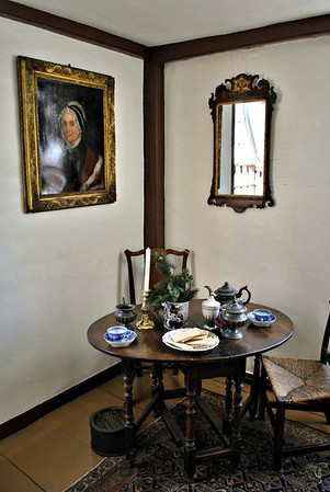 Period table in the front room with the portrait of Aunt Ruth above.