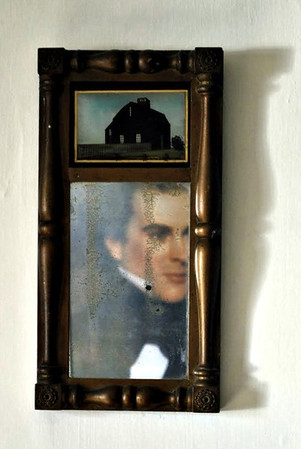 Picture of Hawthorne reflected in the room's mirror.