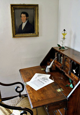 Fall-front desk in the front room; portrait above was a friend of Hawthorne's father.