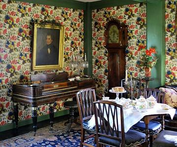 Hawthorne's portrait over the pianoforte.