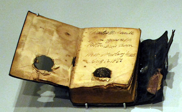 1816 New Testament of Our Lord and Savior Jesus Christ with an embedded bullet