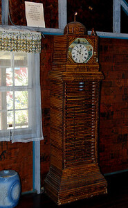 The Paper House grandfather clock made from Sunday papers from the capital cities of the then 48 states.