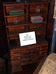 A bookcase made of papers from foreign countries.