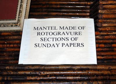 The mantel is made up of the rotogravure (pictorial) sections of the Boston Sunday Herald and New York Herald Tribune.