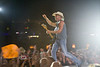 Kenny Chesney Running Across the Stage in the Rain - Cheyenne Frontier Days Rodeo - Photo by Pat Bonish