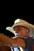 Kenny Chesney looking back at the camera on stage at Cheyenne Frontier Days in Wyoming - Photo by Pat Bonish