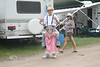This Poor Girl had to carry this guy on her back the entire festival - WeFest 2010 - PHoto by Pat Bonish