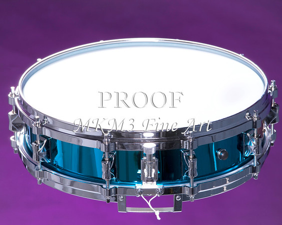 A metallic blue snare drum isolated against a purple background in the horizontal format.<br /> <br /> Keywords associated with these photographs are: Drum, drums, snare, sticks, drum set, trap drum set, music, jazz, band, orchestra, marching, percussion, cymbal, drummer, drumming, drum art, drum art prints, drum prints, drum pictures, drum photographs, drumset, rock and roll, country music, antique, vintage, trumpet print, trumpet canvas, Wall art, decorative wall art, fine art photography, art photography, photo art, fine arts, art photo, fine art prints, art prints, fine art, fine art canvas, canvas print, photography, photographic, photo, picture, Mac K Miller III, Mac Miller, M K Miller III, art, modern wall art, wall art ideas, wall art décor, abstract wall art, bathroom wall art, wall art décor, decorative wall art, contemporary wall art, collectable art, cheap art, kitchen wall art, wall art for kitchen,