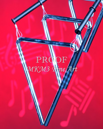 Three musical triangles isolated against a red background in the vertical format with copy space.<br /> <br /> Keywords associated with these photographs are: Drum, drums, snare, sticks, drum set, trap drum set, music, jazz, band, orchestra, marching, percussion, cymbal, drummer, drumming, drum art, drum art prints, drum prints, drum pictures, drum photographs, drumset, rock and roll, country music, antique, vintage, trumpet print, trumpet canvas, Wall art, decorative wall art, fine art photography, art photography, photo art, fine arts, art photo, fine art prints, art prints, fine art, fine art canvas, canvas print, photography, photographic, photo, picture, Mac K Miller III, Mac Miller, M K Miller III, art, modern wall art, wall art ideas, wall art décor, abstract wall art, bathroom wall art, wall art décor, decorative wall art, contemporary wall art, collectable art, cheap art, kitchen wall art, wall art for kitchen,