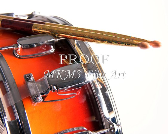 A red fade color snare drum with sticks isolated against a white background in the horizontal format.<br /> <br /> Keywords associated with these photographs are: Drum, drums, snare, sticks, drum set, trap drum set, music, jazz, band, orchestra, marching, percussion, cymbal, drummer, drumming, drum art, drum art prints, drum prints, drum pictures, drum photographs, drumset, rock and roll, country music, antique, vintage, trumpet print, trumpet canvas, Wall art, decorative wall art, fine art photography, art photography, photo art, fine arts, art photo, fine art prints, art prints, fine art, fine art canvas, canvas print, photography, photographic, photo, picture, Mac K Miller III, Mac Miller, M K Miller III, art, modern wall art, wall art ideas, wall art décor, abstract wall art, bathroom wall art, wall art décor, decorative wall art, contemporary wall art, collectable art, cheap art, kitchen wall art, wall art for kitchen,