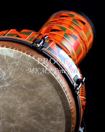 An orange African or Latin Djembe conga drum isolated on black background in the vertical format with copy space.<br /> <br /> Keywords associated with these photographs are: Drum, drums, snare, sticks, drum set, trap drum set, music, jazz, band, orchestra, marching, percussion, cymbal, drummer, drumming, drum art, drum art prints, drum prints, drum pictures, drum photographs, drumset, rock and roll, country music, antique, vintage, trumpet print, trumpet canvas, Wall art, decorative wall art, fine art photography, art photography, photo art, fine arts, art photo, fine art prints, art prints, fine art, fine art canvas, canvas print, photography, photographic, photo, picture, Mac K Miller III, Mac Miller, M K Miller III, art, modern wall art, wall art ideas, wall art décor, abstract wall art, bathroom wall art, wall art décor, decorative wall art, contemporary wall art, collectable art, cheap art, kitchen wall art, wall art for kitchen,