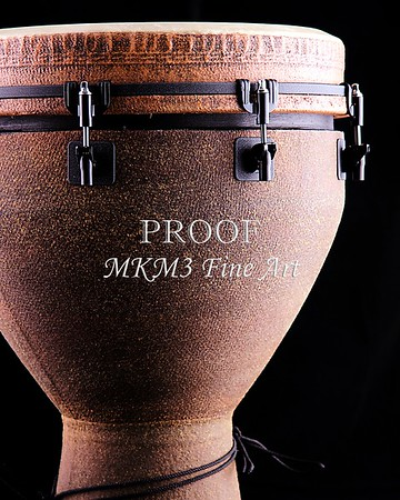 A brown African or Latin Djembe conga drum isolated on black background in the vertical format.<br /> <br /> Keywords associated with these photographs are: Drum, drums, snare, sticks, drum set, trap drum set, music, jazz, band, orchestra, marching, percussion, cymbal, drummer, drumming, drum art, drum art prints, drum prints, drum pictures, drum photographs, drumset, rock and roll, country music, antique, vintage, trumpet print, trumpet canvas, Wall art, decorative wall art, fine art photography, art photography, photo art, fine arts, art photo, fine art prints, art prints, fine art, fine art canvas, canvas print, photography, photographic, photo, picture, Mac K Miller III, Mac Miller, M K Miller III, art, modern wall art, wall art ideas, wall art décor, abstract wall art, bathroom wall art, wall art décor, decorative wall art, contemporary wall art, collectable art, cheap art, kitchen wall art, wall art for kitchen,