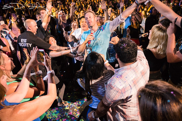 Lead singer, Chris Martin is seen interacting with fans in the crowd during the band Coldplays performance at Bankers Life in Indianapolis on July 20, 2017.