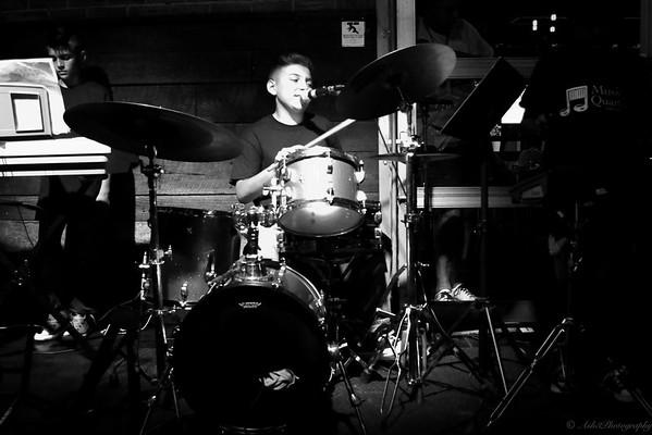 Lorenzo on drums.