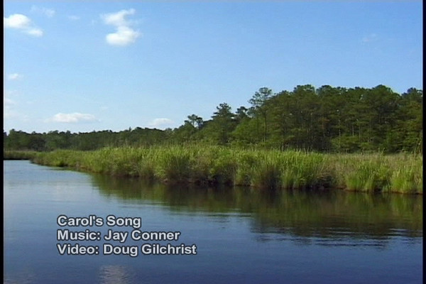 Carol's Song features scenic shots of sailing and boating from Beaufort, to Oriental on creeks and rivers to Ocracoke Island. There are beautiful shots of places not often seen or featured in other Carolina Seascapes.