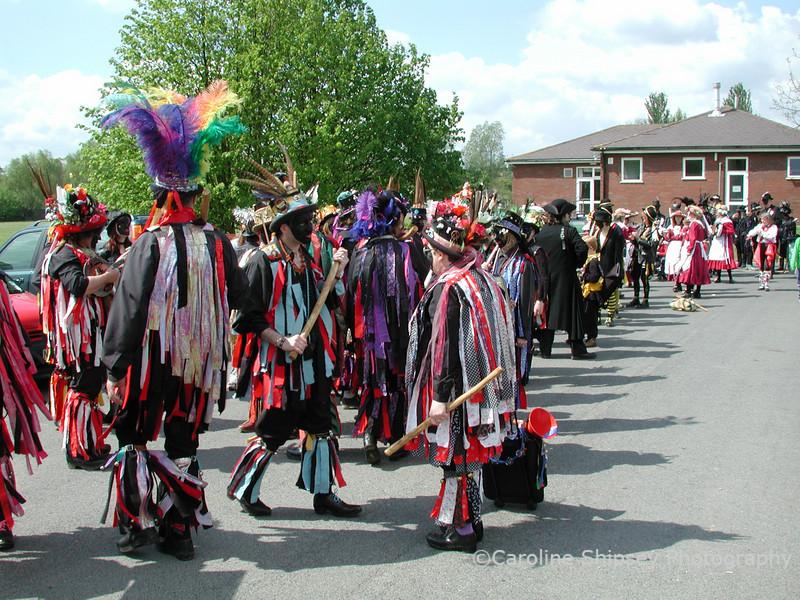 preparing for the big procession  Upton on Severn Folk Festival 2002