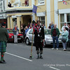 Richard Hannay & piper leading the big procession  Upton on Severn Folk Festival 2002