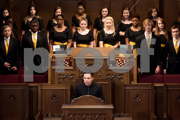 Dr. Eric Posada speaks at a Tyler Junior College choir concert at Marvin United Methodist Church in Tyler, Texas, on Wednesday, Nov. 29, 2017. Hundreds came to enjoy Christmas classics sung by the choirs. (Chelsea Purgahn/Tyler Morning Telegraph)