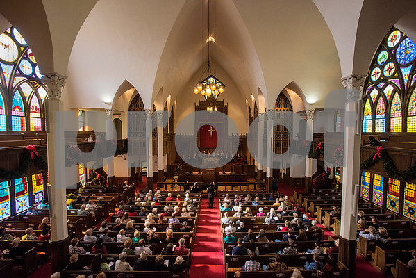 The audience listens as the choir sings during a Tyler Junior College choir concert at Marvin United Methodist Church in Tyler, Texas, on Wednesday, Nov. 29, 2017. Hundreds came to enjoy Christmas classics sung by the choirs. (Chelsea Purgahn/Tyler Morning Telegraph)