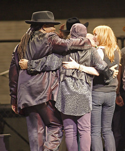 E STREET BAND MEMBERS SHARE A HUG AT ORLANDO VOTE FOR CHANGE CONCERT END