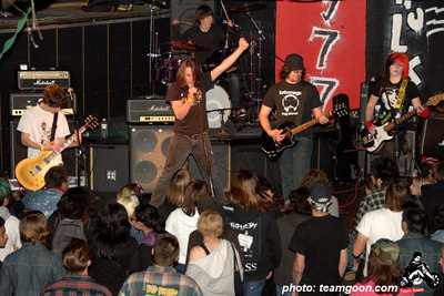 Wrecking Crew - Skulls last show at The Showcase Theater - Corona, CA - March 10, 2006  Part 2: Next up was another band from San Diego called Wrecking Crew. With a name that is an allusion to the epically great Adolescents, you would think this band might sound something akin to the Adolescents; if so, you would be absolutely right. The first time I head this band live, my jaw dropped. No, I do not have leprosy, it's just that when this youthful five piece does its thing, it is that impressive. I had written in a previous column that Wrecking Crew's only flaw is sounding too much like the Adolescents, but that is no longer a problem. A bit of time has passed, and the band has continued to develop its own admirable, jamming character. Even so, dual lead guitarist Joe's Harrison aggressive and precise playing style is so much like the great (and erratic) Rikk Agnew its weird. Fucking rad! Wrecking Crew has a new six-song EP available from Finger Records. They should send me one and you should go buy one. Check out: www.wreckingcrewsd.com.