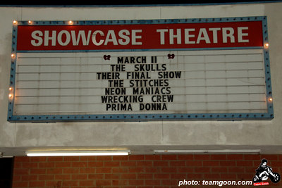 """Showcase Marque - Skulls last show at The Showcase Theater - Corona, CA - March 10, 2006  The Skulls final show - Report filed by: Team Goon Senior Writter -Marcus Solomon  Part 1: Thanks to everyone in The Skulls for agreeing to do another """"final show"""" at Showcase Theatre in Corona CA so the rest of us could attend. The previous """"final show"""" had been held on January 20th in San Diego at some place called Jumping Turtle, but after a few angry rants from people such as me, the band agreed to go at it one more time. Vocalist Billy Bones told me that we had guitarist Kevin Preston to thank for this special last gig. Hmm…it seems we have Kevin to thank for originally getting the band back together again, Kevin to thank for being the primary reason the band has now broken up, and Kevin to thank for doing it one more time.  The Master of Ceremonies for the entire was Mr. Bruce Moreland (Aka: Bruce Barf). Bruce was the MC for The Masque, which was the first punk club in Los Angeles back in opening way, way, back in 1977. Bruce is also the brother of the dear, departed Mark Moreland, founder and lead guitarist of the legendary Wall of Voodoo.   First up was a band from San Diego named The Sex Girls. No, it is not what you think, and no, I did not see this band. That's too bad, because judging from the band's MySpace profile, these four dudes play some really cool punkness reminiscent of The Stooges and The New York Dolls, albeit a bit more sloppy and apparently without vocals."""