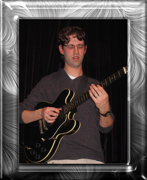 Dave Kain, leader and guitarist [greyswirled gradient koshblack1 frame]