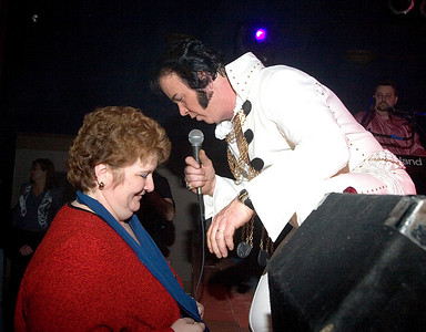 Matt Ragano as Elvis Presley serenades Terri Vetter of Belvidere at the Apollo Theater.