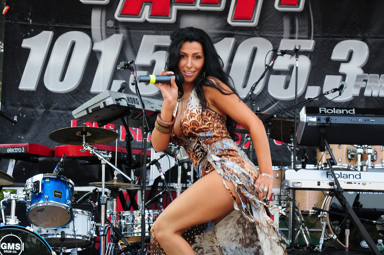Medford, NY - JULY 17: Reina Performs at the 2010 Party FM's Mega Jam Hosted By Nickelodeon's I- Carly, Miranda Cosgrove at the Country Fair Entertainment Park Route 112, Medford, NY (Photo by Joseph Bellantoni/In House Image)