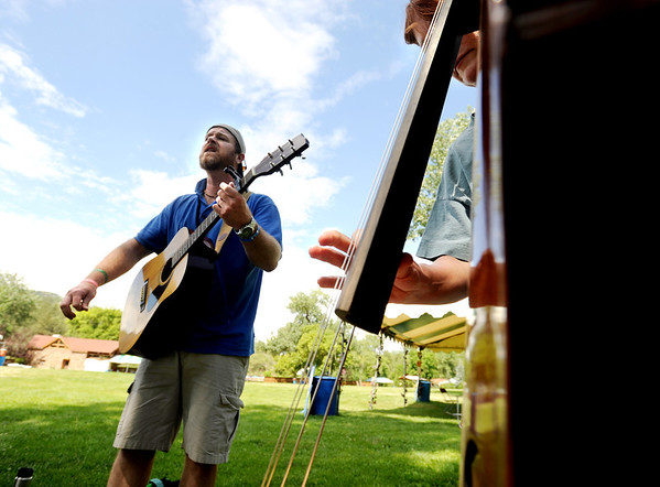 """Dylan Taliaferro, left, plays with a small group, including Caroline Watt, right, on bass, during the class time.<br /> Over 300 students are learning from the bluegrass masters during the 2011 Rocky Grass Academy in Lyons this week.<br /> For more photos and a video of the academy, go to  <a href=""""http://www.dailycamera.com"""">http://www.dailycamera.com</a>.<br /> Cliff Grassmick / July 26, 2011"""