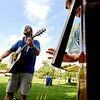 "Dylan Taliaferro, left, plays with a small group, including Caroline Watt, right, on bass, during the class time.<br /> Over 300 students are learning from the bluegrass masters during the 2011 Rocky Grass Academy in Lyons this week.<br /> For more photos and a video of the academy, go to  <a href=""http://www.dailycamera.com"">http://www.dailycamera.com</a>.<br /> Cliff Grassmick / July 26, 2011"