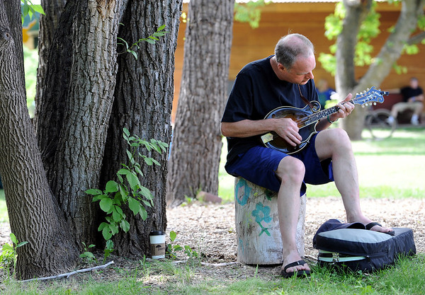 """Bob Calswell of Virginia, takes some time alone to play at Rocky Grass.<br /> Over 300 students are learning from the bluegrass masters during the 2011 Rocky Grass Academy in Lyons this week.<br /> For more photos and a video of the academy, go to  <a href=""""http://www.dailycamera.com"""">http://www.dailycamera.com</a>.<br /> Cliff Grassmick / July 26, 2011"""