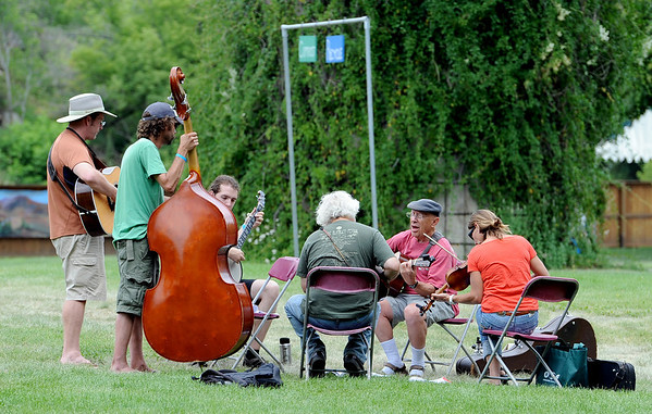 """Music students break into groups to play during class time at Rocky Grass.<br /> Over 300 students are learning from the bluegrass masters during the 2011 Rocky Grass Academy in Lyons this week.<br /> For more photos and a video of the academy, go to  <a href=""""http://www.dailycamera.com"""">http://www.dailycamera.com</a>.<br /> Cliff Grassmick / July 26, 2011"""