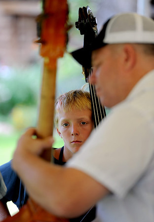 "Nate Freeman, 11, watches Mike Bub play the bass.<br /> Over 300 students are learning from the bluegrass masters during the 2011 Rocky Grass Academy in Lyons this week.<br /> For more photos and a video of the academy, go to  <a href=""http://www.dailycamera.com"">http://www.dailycamera.com</a>.<br /> Cliff Grassmick / July 26, 2011"