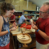 "Madi Stuart works on her new instrument with help from instructor, Dan Roberts, during class time.<br /> Over 300 students are learning from the bluegrass masters during the 2011 Rocky Grass Academy in Lyons this week.<br /> For more photos and a video of the academy, go to  <a href=""http://www.dailycamera.com"">http://www.dailycamera.com</a>.<br /> Cliff Grassmick / July 26, 2011"