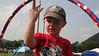 Liam demonstrating his mad hula hoop skillz during the David Mayfield parade set.