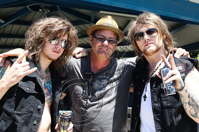 SAN BERNARDINO, CA - JUNE 30:  (L-R) Guitarist Ben Bruce of Asking Alexandria, Mayhem festival creator Kevin Lyman and vocalist Danny Worsnop of Asking Alexandria pose backstage at the Rockstar Energy Drink Mayhem Festival at San Manuel Amphitheater on June 30, 2012 in San Bernardino, California.  (Photo by Chelsea Lauren/Getty Images)