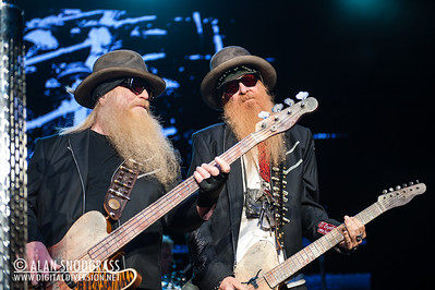 Dusty Hill (L) and Billy Gibbons of ZZ Top perform August 19, 2012 at Sleep Train Pavilion in Concord, California