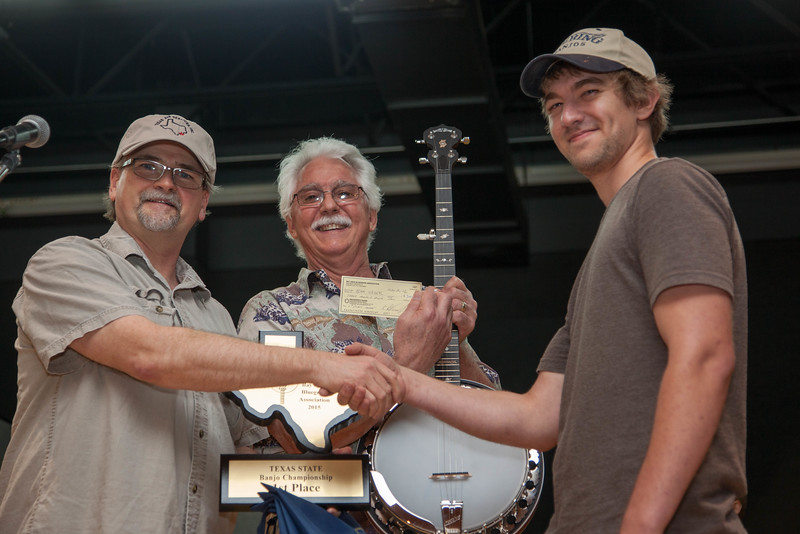 """1st place and Texas Banjo Champion for 2015:  $300, trophy, paid entry to the national finals at Winfield Kansas, and a Deering """"Boston"""" banjo<br /> Adam Greer<br /> Burton, Texas"""