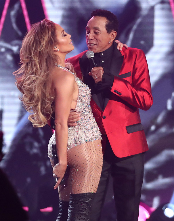 . Jennifer Lopez, left, and Smokey Robinson perform a medley during a tribute to Motown\'s 60th anniversary at the 61st annual Grammy Awards on Sunday, Feb. 10, 2019, in Los Angeles. (Photo by Matt Sayles/Invision/AP)