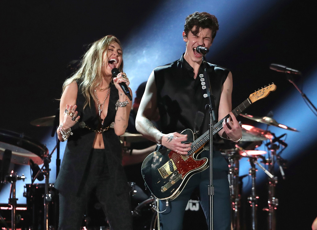 ". Miley Cyrus, left, and Shawn Mendes perform ""In My Blood\"" at the 61st annual Grammy Awards on Sunday, Feb. 10, 2019, in Los Angeles. (Photo by Matt Sayles/Invision/AP)"