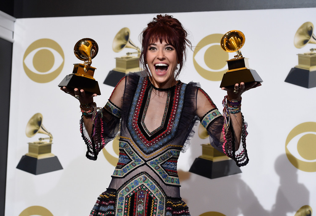". Laura Daigle poses in the press room with the awards for best contemporary christian music performance/song for ""You Say\"" and best contemporary christian music album for \""Look Up Child\"" at the 61st annual Grammy Awards at the Staples Center on Sunday, Feb. 10, 2019, in Los Angeles. (Photo by Chris Pizzello/Invision/AP)"