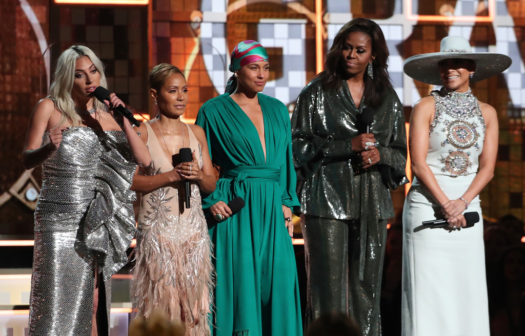 . Lady Gaga, from left, Jada Pinkett Smith, Alicia Keys, Michelle Obama and Jennifer Lopez speak at the 61st annual Grammy Awards on Sunday, Feb. 10, 2019, in Los Angeles. (Photo by Matt Sayles/Invision/AP)