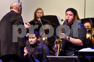 Director Dr. Steven Meier, left, conducts as a member of Jazz Ensemble 2 performs a solo during Tyler Junior College's Jazz Festival at Wise Auditorium in Tyler, Texas, on Thursday, March 1, 2018. Special guest artists were Vince DiMartino on trumpet and George Faber on piano. (Chelsea Purgahn/Tyler Morning Telegraph)