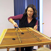 Tina Bergmann demonstrates the layout of the hammered dulcimer.
