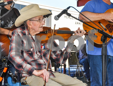 """87 year old """"Wild"""" Bill May competes in the Senior Division of the 87th Annual Old Fiddlers Contest & Reunion in Athens. The contest included 6 divisions with over $5000 being awarded in cash prizes and was held on Saturday, May 26. (Jessica T. Payne/Tyler Paper)"""
