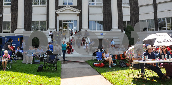 People gather on the steps of The City of Athens Courthouse on Saturday, May 26 to enjoy the 87th Annual Old Fiddlers Contest & Reunion. The Fiddlers Contest has been held on the Courthouse Square since 1934 to care for the ever-expanding crowds of music lovers. (Jessica T. Payne/Tyler Paper)